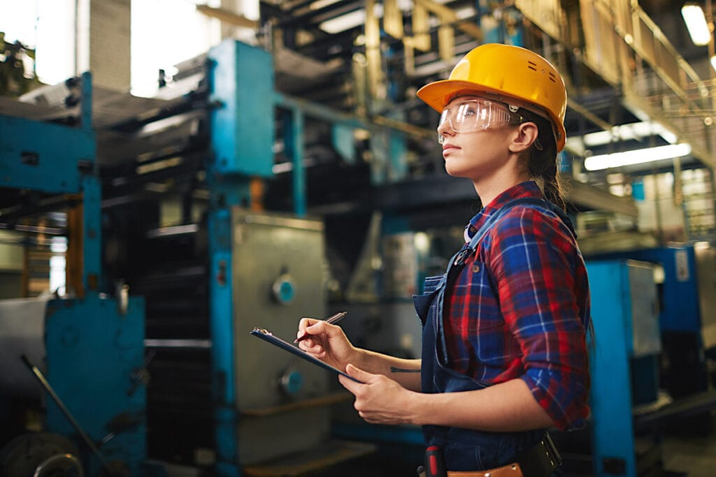 woman in factory with clipboard