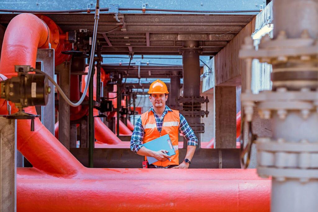 Worker under HVAC dunnage