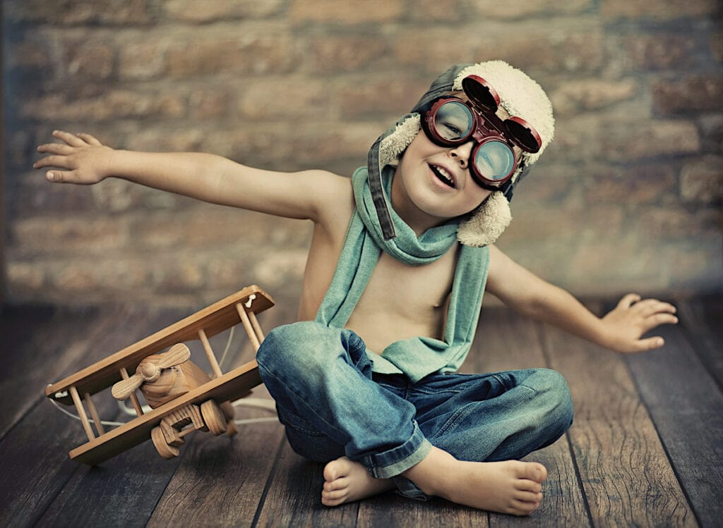 Boy Aviator With Wooden Toy Plane